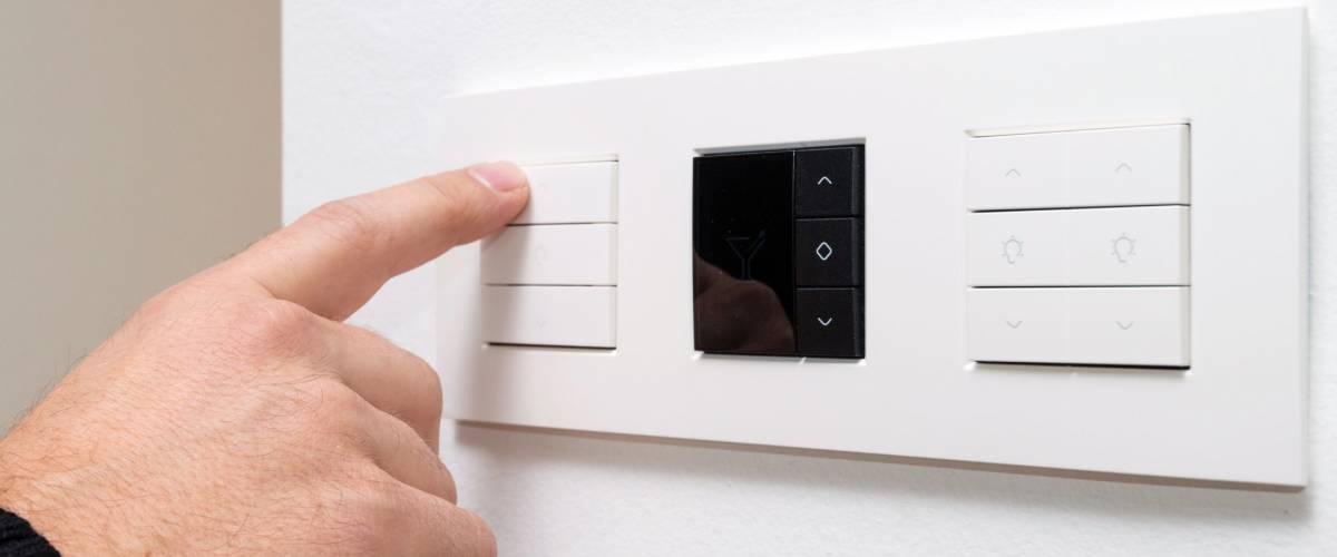 Closeup shot of man's hand controlling multipurpose switch