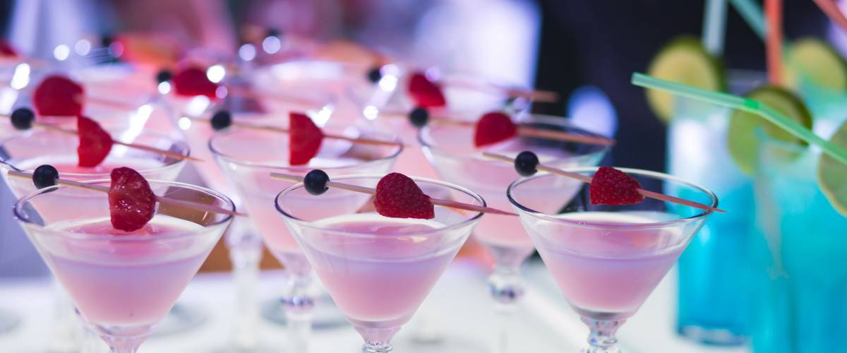 Beautiful row of signature cocktails at a wedding