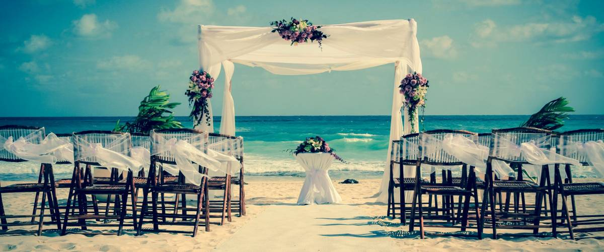 Wedding altar on the beach in Mexico with the ocean in the background